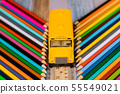 School supplies ,colored pencils and toy student 55549021