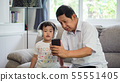 happy Grandfather and grandson Sharing smartphone 55551405