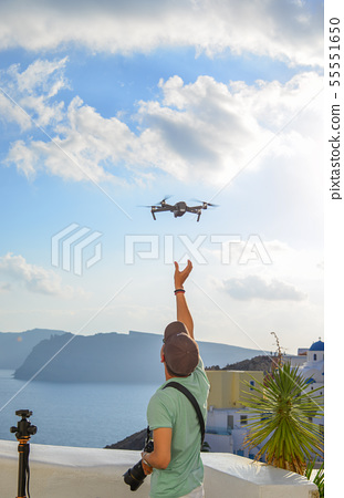 A traveler using drone 55551650
