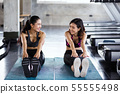 Fitness women stretch hands to legs 55555498