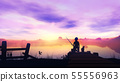 The boy is fishing in the river from a wooden pier at sunrise 55556963
