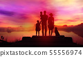 Family on wooden pier at bright sunset background 55556974
