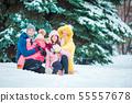 Happy family enjoy winter snowy day 55557678