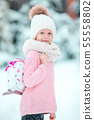 Cute little kid girl is going skate outdoors. 55558802