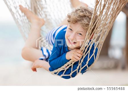 kid at tropical vacation 55565488