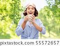 woman in pajama and sleeping mask drinking coffee 55572657