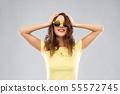 teenage girl in yellow sunglasses and t-shirt 55572745