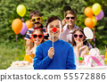 happy boy with red clown nose at birthday party 55572886