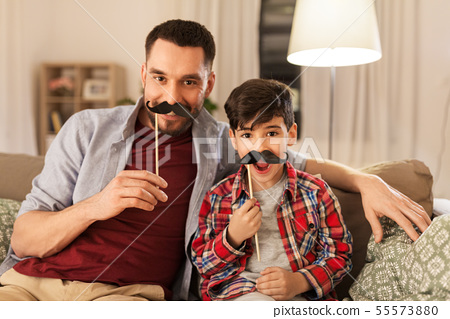 father and son with mustaches having fun 55573880