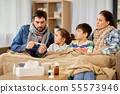 family with ill children having fever at home 55573946