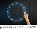 hand using interactive panel with signs of zodiac 55574291