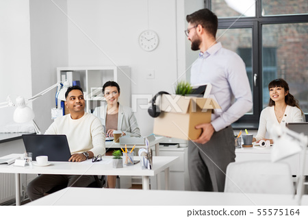 happy male office worker with personal stuff 55575164