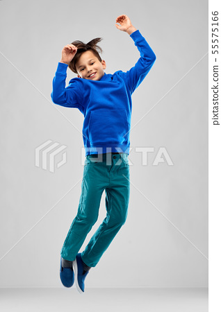 portrait of smiling boy in blue hoodie jumping 55575166