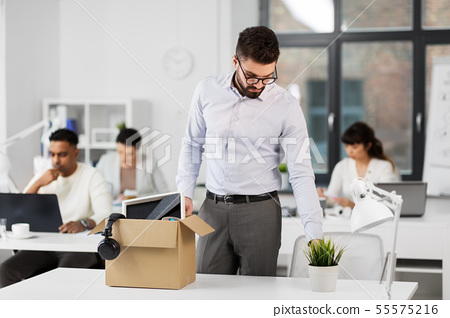 sad fired male office worker with personal stuff 55575216