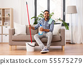indian man with mop and detergent cleaning at home 55575279