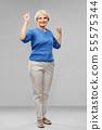 portrait of happy senior woman celebrating success 55575344