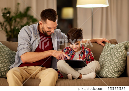 father and son with tablet pc playing at home 55575585