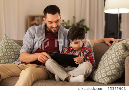 father and son with tablet pc playing at home 55575908