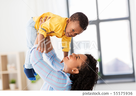 happy african american mother with baby at home 55575936