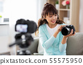 asian female blogger with camera recording video 55575950
