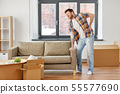 man having back ache moving to new home 55577690