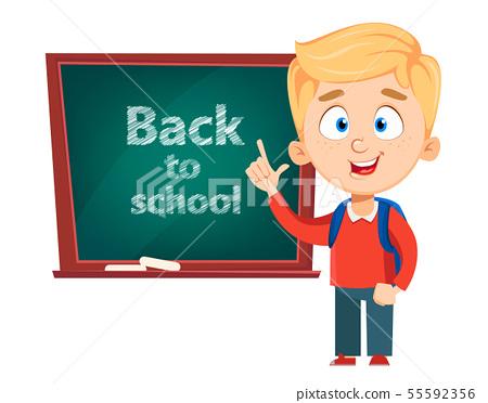 Cute schoolboy standing near blackboard 55592356