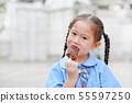 Portrait of little Asian child girl in school 55597250