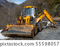 heavy construction loader bulldozer on the side of 55598057