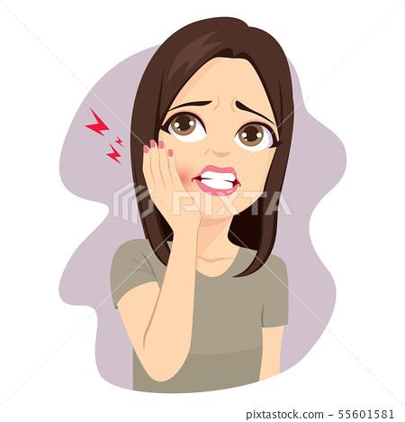 Woman touching cheek suffering toothache pain 55601581