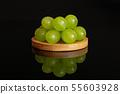 Fresh green grape isolated on black glass 55603928