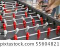 People play foosball closeup indoor 55604821