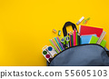Backpack with stationery inside on yellow background 55605103