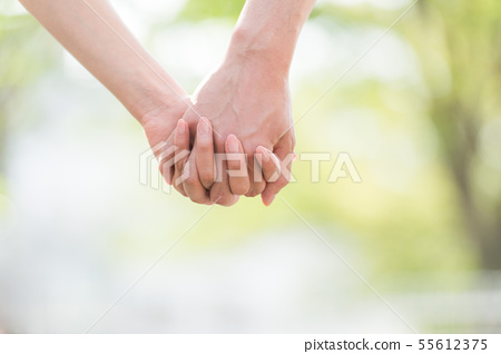 Hand holding body parts 55612375