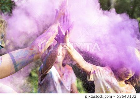 People celebrating Holi, Festival of Colors 55643132