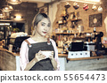 Asian Women Holding Coffee Cup  At Cafe 55654473