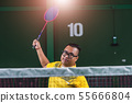 Man Asian badminton player serve action play 55666804