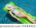 Portrait beautiful young asian woman smile happy relax and leisure in the swimming pool 55684402