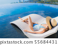 Portrait beautiful young asian woman smile happy relax around swimming pool in hotel resort with sea and ocean view 55684431