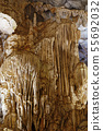 Stalactites and flow stones in a marble cave 55692032