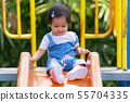 Happy small child on the playground in the park 55704335