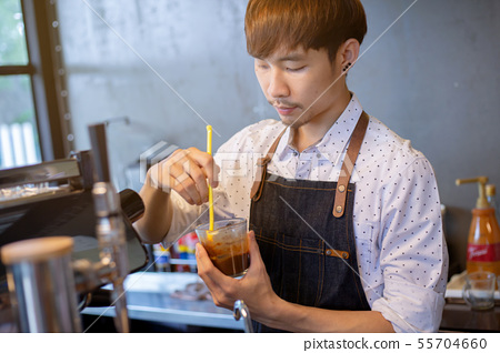 Asian barista at work during making coffee, 55704660