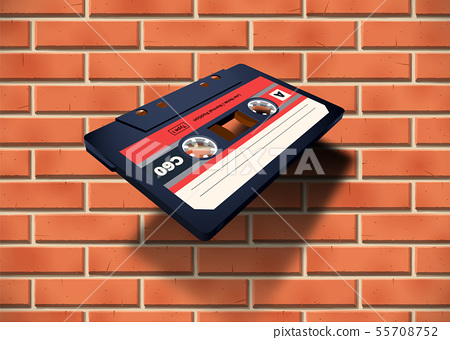 Compact cassette with C60 tape in perspective view near the brick wall 55708752