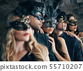 Group of people in masquerade carnival mask posing in studio 55710207
