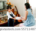 Asian daughter gives gift box to her mother 55711487