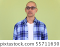 Face of handsome bald hipster man with eyeglasses thinking 55711630