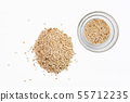 Top view of sesame seeds in a little dish and 55712235