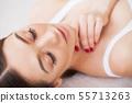 Woman Eye with Long Eyelashes. Beautiful Young Woman During Eyelash Extension 55713263