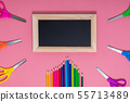 Back to school concept. Black wooden chalkboard. School supplies on pink background 55713489