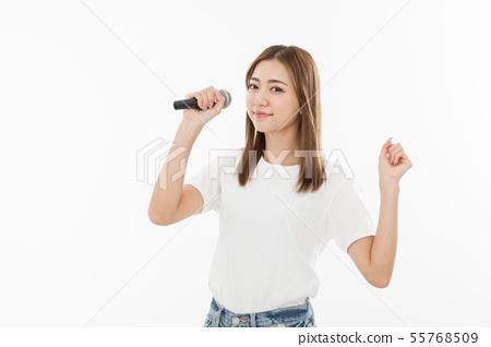 Young woman singing microphone Karaoke 55768509