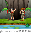 Cartoon of scout boy and girl exploring nature 55808118